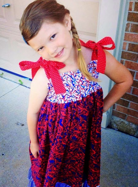 Isabel in her patriotic maxi dress by Daydream Believers Designs
