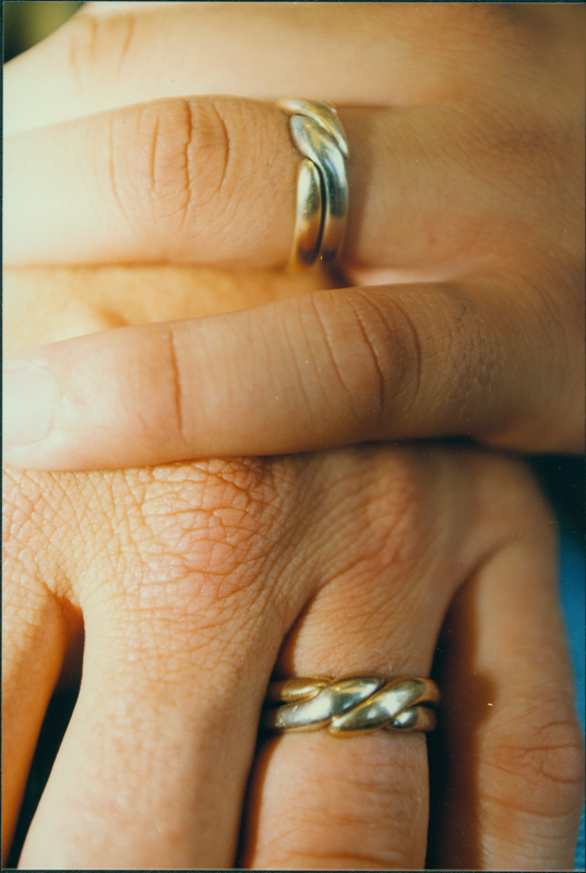 Close-up of a gay couple's wedding rings. Undated.