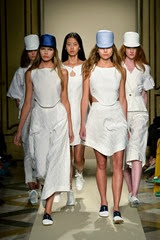 MILAN, ITALY - SEPTEMBER 22:  Models walk the runway during the Sergei Grinko show as a part of Milan Fashion Week Womenswear Spring/Summer 2014 at  on September 22, 2013 in Milan, Italy.  (Photo by Tullio M. Puglia/Getty Images for Sergei Grinko)