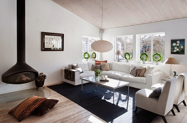 swedish-home-style-with-hanging-fireplace-and-black-carpet-also-white-sofa