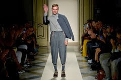 MILAN, ITALY - SEPTEMBER 22:  Designer Sergei Grinko acknowledges the applause of the public after the Sergei Grinko show as a part of Milan Fashion Week Womenswear Spring/Summer 2014 at  on September 22, 2013 in Milan, Italy.  (Photo by Tullio M. Puglia/Getty Images for Sergei Grinko)