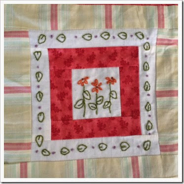 red flower stitchery