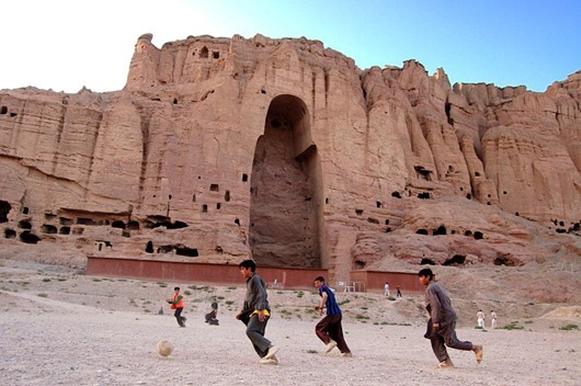 Afghan Boys Play Football in Front of Buddha of Bamyan