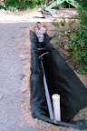 French Drain Line, wrapped in fabric.