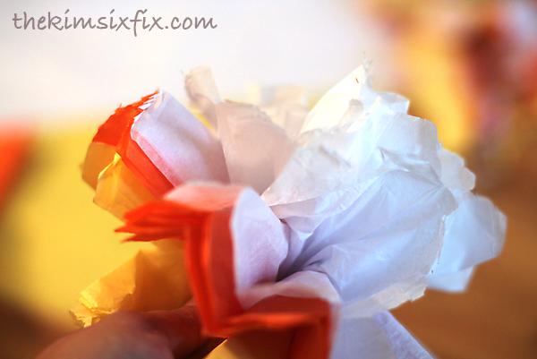 Fluffing tissue paper pompom