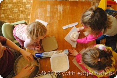 little girls making pizzas