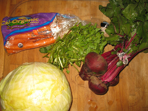 Here's what went into the juice I made from a recipe in Whole Living: beets, watercress, carrots, and cabbage.