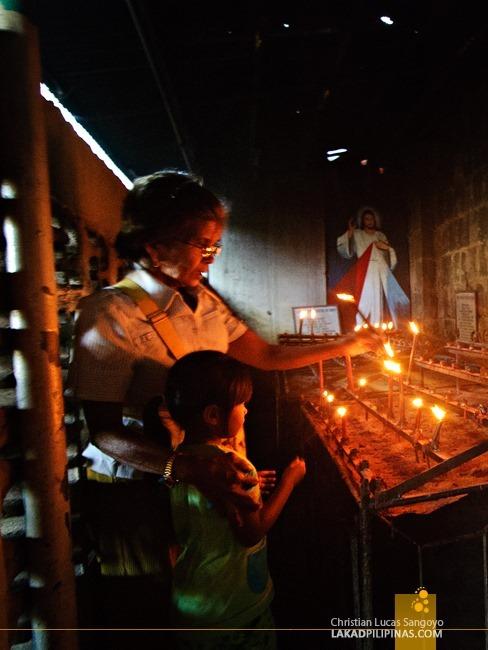 Saying a Prayer at Bolinao Church in Pangasinan