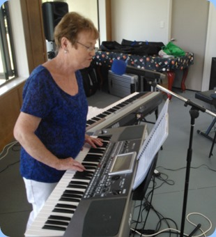 Our Events Manager, Diane Lyons, playing and singing using her Korg Pa900.