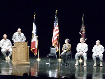 Sgt. Rob Radosevich, Lt. Col. Kevin J. Cruse (at podium), Mayor Sandra Johnson, Command Sgt. Major William P. Thayer, Chaplain Capt. Paul Weber