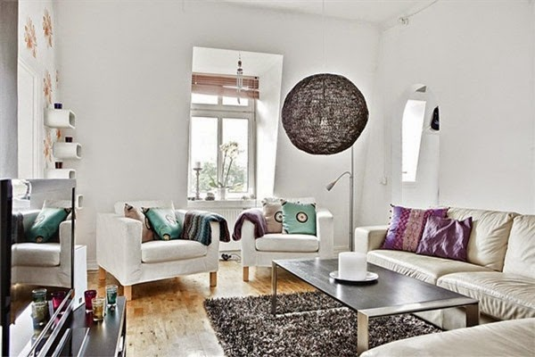 Modern-soft-living-room-design-with-white-sofa-black-table-carpet-blue-and-purple-pillow-lamp-window-hardwood-floor-design