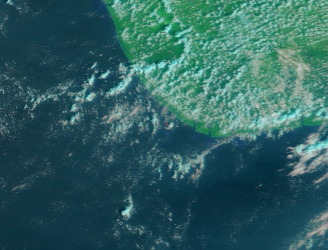 MODIS-Terra satellite image of Niger Delta showing fire from Chevron offshore well blowout (red spot at center), on 5 February 2012. Courtesy NASA / MODIS Rapid Response Team via skytruth.org