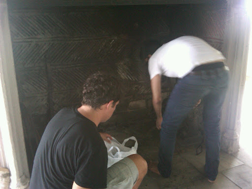 Anthony and Muzam prepping the fireplace so we can load it with logs and glowing pillar candles.