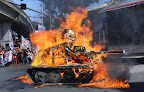 Protesters burn an effigy of President Noynoy Aquino atop a battle tank representing Oplan Bayanihan. (Photo by Pom Cahilog-Villanueva)