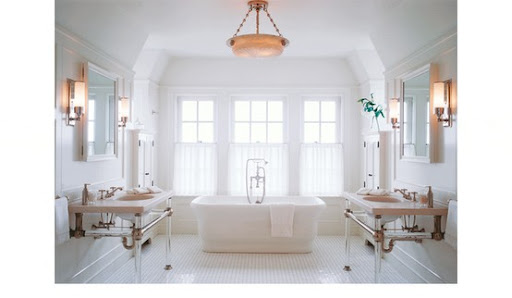This airy bathroom allows for separate his and hers vanities and a great place to meet in the middle. (mixandchic.com)