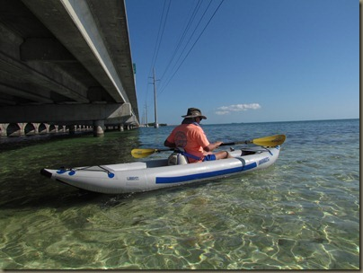 al kayaking under bridge by sunshine key