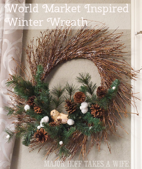 World Market inspired wreath. World Market inspired wreath. A fun twist on a Christmas wreath. Make a winter wreath that will last all season long and well past. This cute grapevine wreath is adorned with a tiny bird, pinecones, greenery and pom poms. You won't believe how cheap and easy this was to make! And so simple! #Christmas #winter #holiday #wreath #nature #knockoff