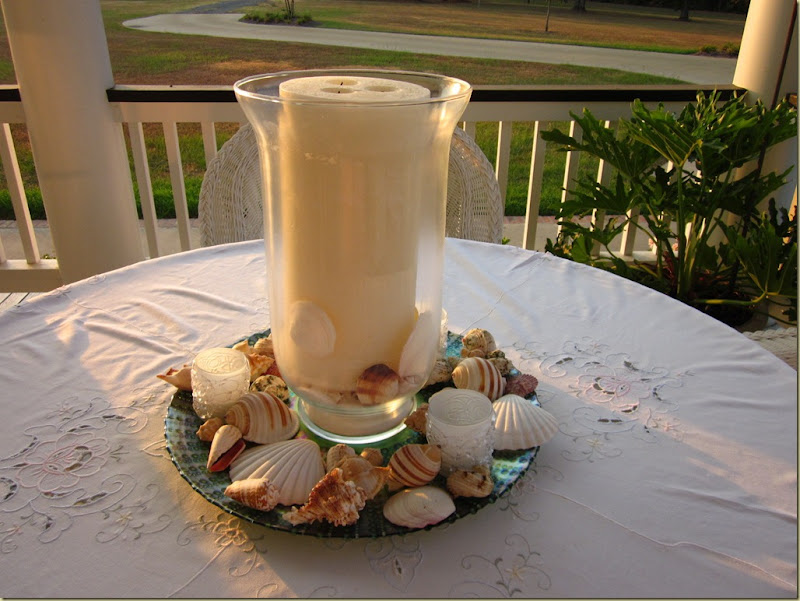large shell candle outside