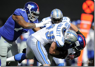 "Detroit Lions linebacker Zack Follett, ""the Pain Train,"" tackling New York Giant running back Brandon Jacobs"