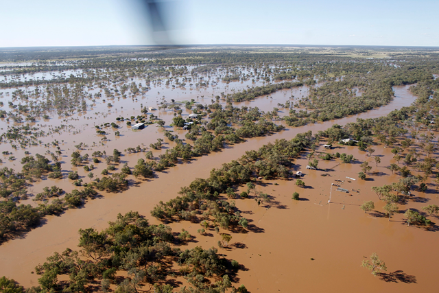 In this photo released by The Royal Australian Air Force, an Australian Air Force helicopter flies over flooded property during an evacuation of flood victims, 29 miles south of Charleville in Queensland state, Australia, Monday, 6 February 2012. AP PHOTO / ROYAL AUSTRALIAN AIR FORCE, LEADING AIRCRAFTMAN BENJAMIN EVANS