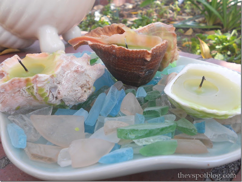 sea glass, shell, candle