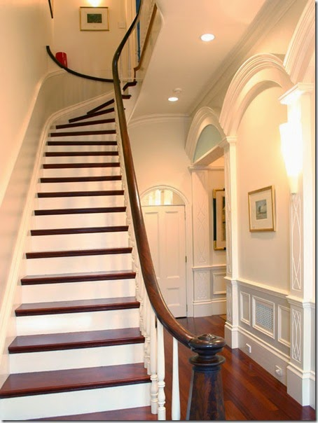 Exciting-Traditional-Staircase-Design-Using-Wooden-Balustrade-and-Wood-Steps-at-Hall-with-Darkwood-Floor-and-Wall-Lamps-South-End
