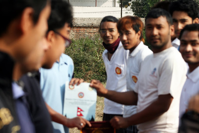 Handshaking between two Rotaract Club Teams