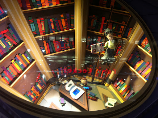 The librarian in this window moves back and forth on her ladder while Virginia is below reading a book.