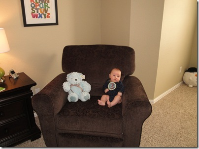 4.  Sitting in chair with bear
