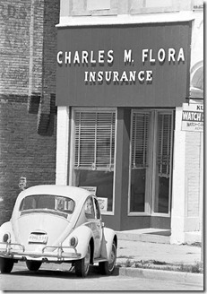 The Charles M. Flora Insurance Agency, 111 W. Franklin Street, Delphi, circa 1974. Charles bought the building on the north side of the courthouse square in 1955 and used the first floor for an office until his retirement in the 1970s. The car is John's first car, a Fontana gray 1965 Volkswagen beetle.