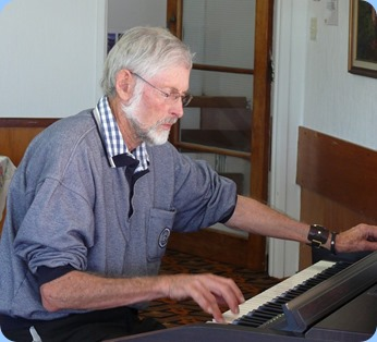 Errol Storey giving the Clavinova a go.  Photo courtesy of Dennis Lyons.