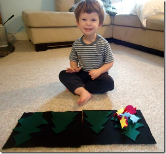 Saylor playing with felt Christmas trees