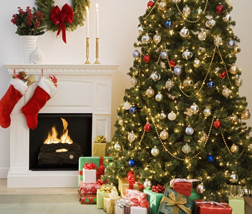 Christmas tree with presents and fireplace with stockings --- Image by &#169; Royalty-Free/Corbis