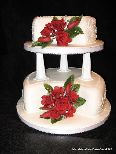 Beautiful 2 tier wedding cake with deep red sugar roses