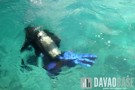 Diver underwater to help clean up Talicud's waters