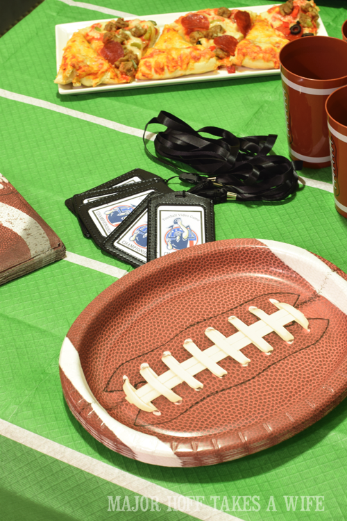 How to set a table for a football party. Looking for a fun party for your teenage boy? Why not throw a Football video game party? Easy ideas for how to entertain kiddos during the Big Game. Features DiGiorno pizza, personalized football cups, free printable lanyards, and an incredible recipe for football shaped ice cream sandwiches! #GameTimeMVP #CollectiveBias #ad