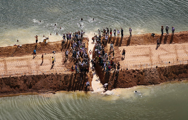 Aerial view of protesters at the Belo Monte dam site in Brazil. Mario Tama / Getty Images