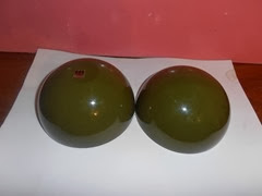 Olive green plastic storage ball with a black interior by ATC