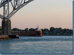 3716 Ontario Sarnia - Blue Water Bridge over St Clair River at sunset - Great Lakes Trader barge being pushed by the tug Joyce L. VanEnkevort