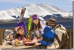 Breckenridge family dining w mountain backround