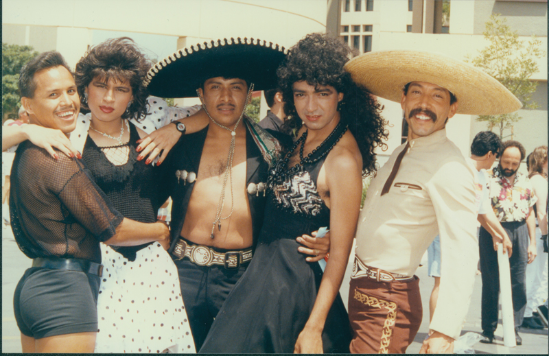 Five Latinos dressed for the Orange County Gay Pride Festival. 1991.