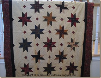 new star quilt with caption