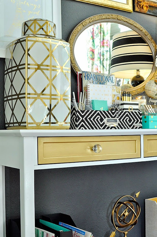 Curated accessories in varying colors and patterns really make this office space unique and glamorous.