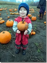 Saylor holding his pumpkin