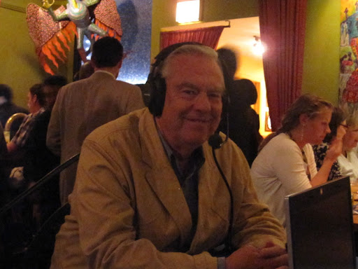 Bill Kurtis enjoys the conversation.