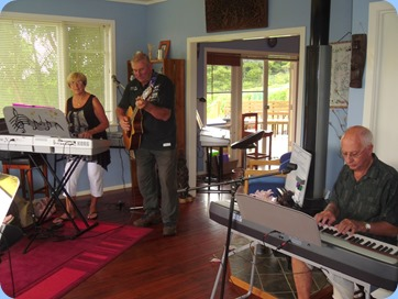 Jan and Kevin Johnston playing their lively music with John Perkin accompanying on digital piano
