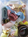 A bin of ribbons that we gathered. We get many of our ribbons from Mokuba NY.