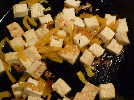 Tofu and yellow bell peppers sauteed until the peppers are tender and the tofu is lightly browned in spots.