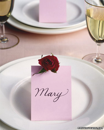 Place cards adorned with small rose blooms are sure to delight your guests. Theyre easy enough to make, and they certainly fit the mood!