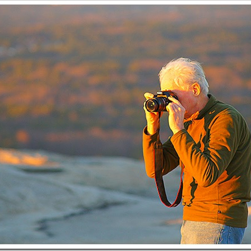 Old man taking a photo